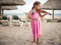 Girl on the Beach Playing the Violin