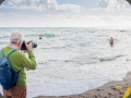 Photographer on the beach capturing charity swim, Fuengirola
