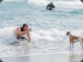 Guy luring dog into the sea with a ball - Rich PhotoVideo