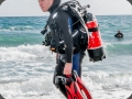 Safety diver wearing CocaCola air bottle