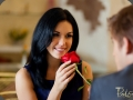 Guy giving red rose to woman