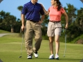Golf Couple walking together